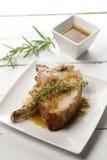 Pork chop with sauce Royalty Free Stock Photos