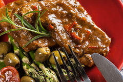 Pork chop with sauce and asparagus Royalty Free Stock Image