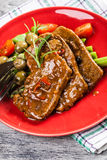 Pork chop with sauce and asparagus Stock Image