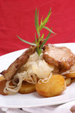 pork chop, sauerkraut and roasted potato Royalty Free Stock Images