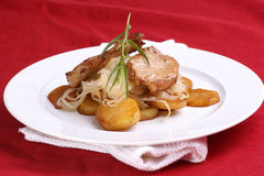 pork chop, sauerkraut and roasted potato Royalty Free Stock Photo