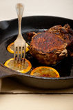 Pork chop seared on iron skillet Stock Photo