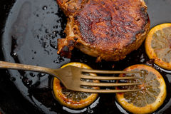 Pork chop seared on iron skillet Royalty Free Stock Images