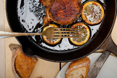 Pork chop seared on iron skillet Stock Image