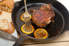 Pork chop seared on iron skillet Stock Images