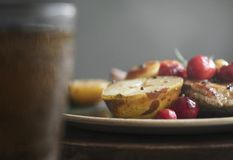 Pork chop served with apples food photography recipe idea royalty free stock photos