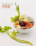 Pork chop soup with mixed vegetables. Stock Image