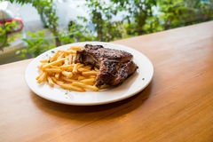 Pork chop steak with French Fries Stock Photos