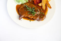 Pork Chop Steak with Fresh Rosemary with Black Pepper Gravy Sauc Stock Photography