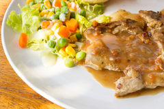 Pork chop steak with salad. Royalty Free Stock Images