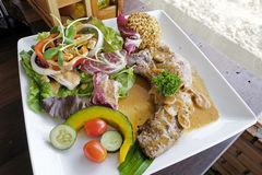 Pork chop steak with salad Stock Photos