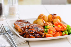 Pork chop Sunday lunch with onion gravy. Stock Image