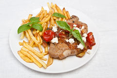 Pork chop with tomato, onion and garlic sauce Stock Photo