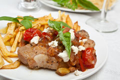 Pork chop with tomato, onion and garlic sauce Royalty Free Stock Image