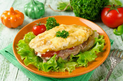Pork chop with tomatoes, potatoes and cheese Royalty Free Stock Photo