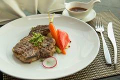 Pork chop on a white plate Stock Photo