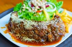 Pork Chop and white sesame sauce. Stock Photos