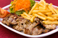 Pork Chop With French Fries And Salad Of Carrot An Stock Photography