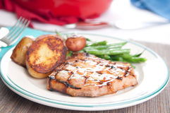 Pork chop wityh peach sauce Stock Images