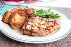 Pork chop wityh peach sauce Stock Photography