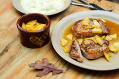 Pork chops with apple sauce Royalty Free Stock Photography