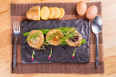 Pork chops ball, baked potatoes and eggs. Royalty Free Stock Photography