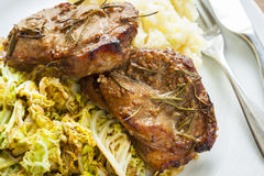 Pork chops on cabbage Royalty Free Stock Image