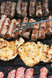 Pork Chops And Cevapcici. This is a close up shot of meat on the barbecue-grill Stock Photo