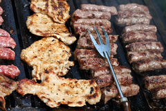 Pork Chops And Cevapcici. This is a close up shot of meat on the barbecue-grill Stock Photos