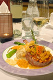 Pork chops entree. Pork entree in a classy fine dining restaurant Stock Photography