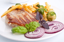 Pork Chops with French Fries Stock Photo