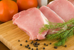Pork chops with fresh dill on a cutting board Stock Photos