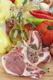 Pork chops. Fresh domestic pork chops with vegetables and oil Stock Photography