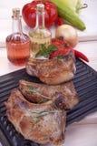 Pork chops. Fresh fried pork chops and vegetables Stock Image