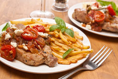Pork Chops with Fries Royalty Free Stock Photos