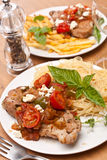 Pork Chops with Fries and Pasta Royalty Free Stock Images