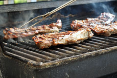Pork Chops on Grill Royalty Free Stock Image