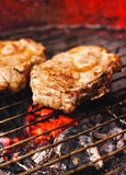 Pork chops on a grill Stock Images