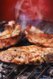 Pork chops on a grill Stock Image