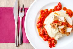 Pork chops with mashed potatoes and tomatoes sauce Royalty Free Stock Images