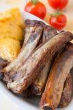 Pork chops and polenta Stock Photography