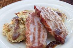 Pork chops and potato cakes royalty free stock photo