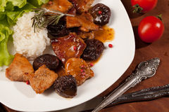 Pork chops with Prune Sause. Colombian recipe Stock Images