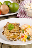 Pork chops with rice salad Royalty Free Stock Images