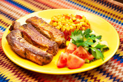 The pork chops with roasted corn Royalty Free Stock Photo