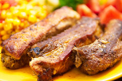 The pork chops with roasted corn Royalty Free Stock Photos