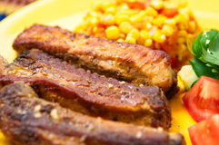 The pork chops with roasted corn Stock Photo