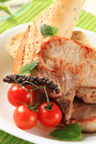 Pork chops and roll Royalty Free Stock Image