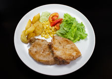Pork chops steak with salad and french fried Stock Image