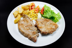Pork chops steak with salad and french fried Stock Photography